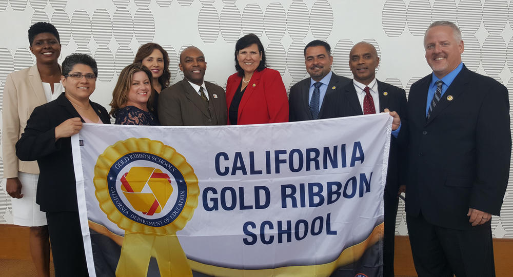 Picture of HSD Administrator with Gold Ribbon Banner